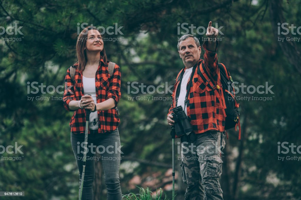 Father and daughter trail hiking stock photo