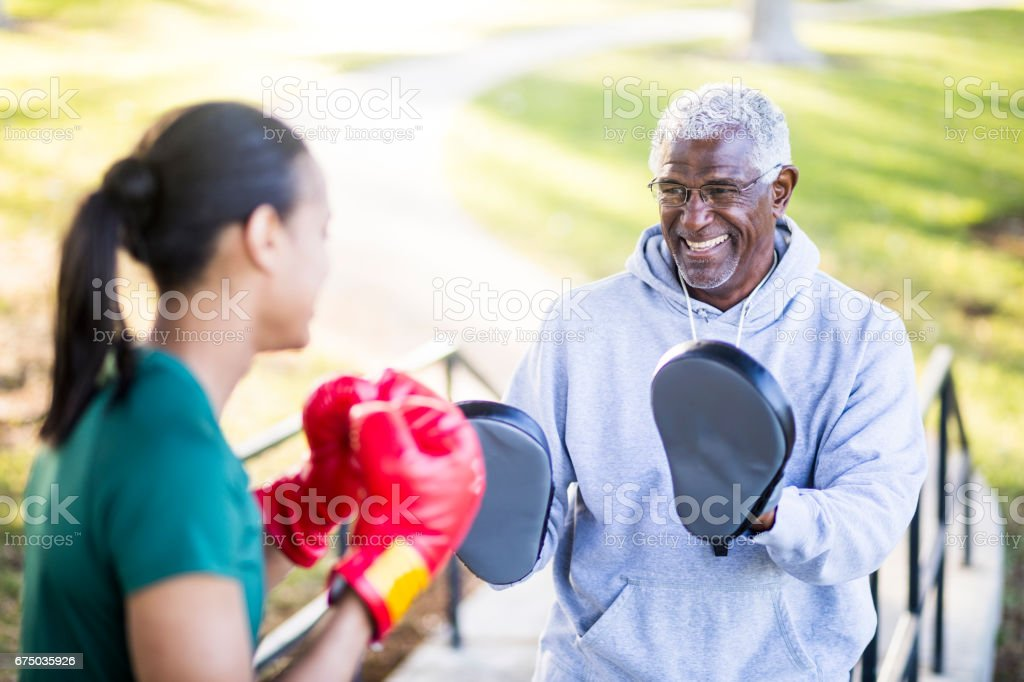Father and Daughter Training Boxing stock photo