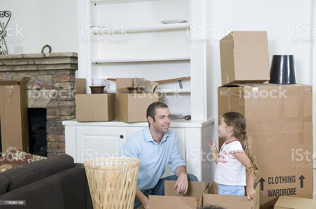 Father and daughter unpacking. Father and daughter unpacking. 25-29 Years Stock Photo
