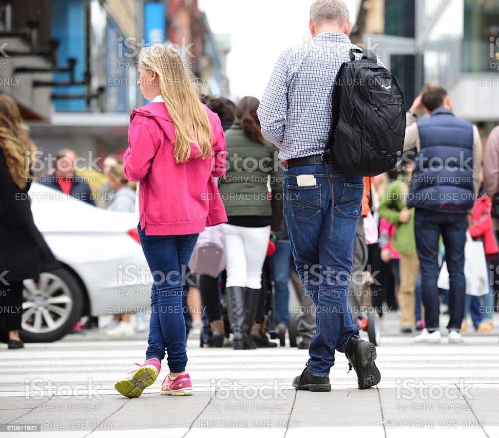 Father and daughter waiting at zebra crossing - Note feet stock photo