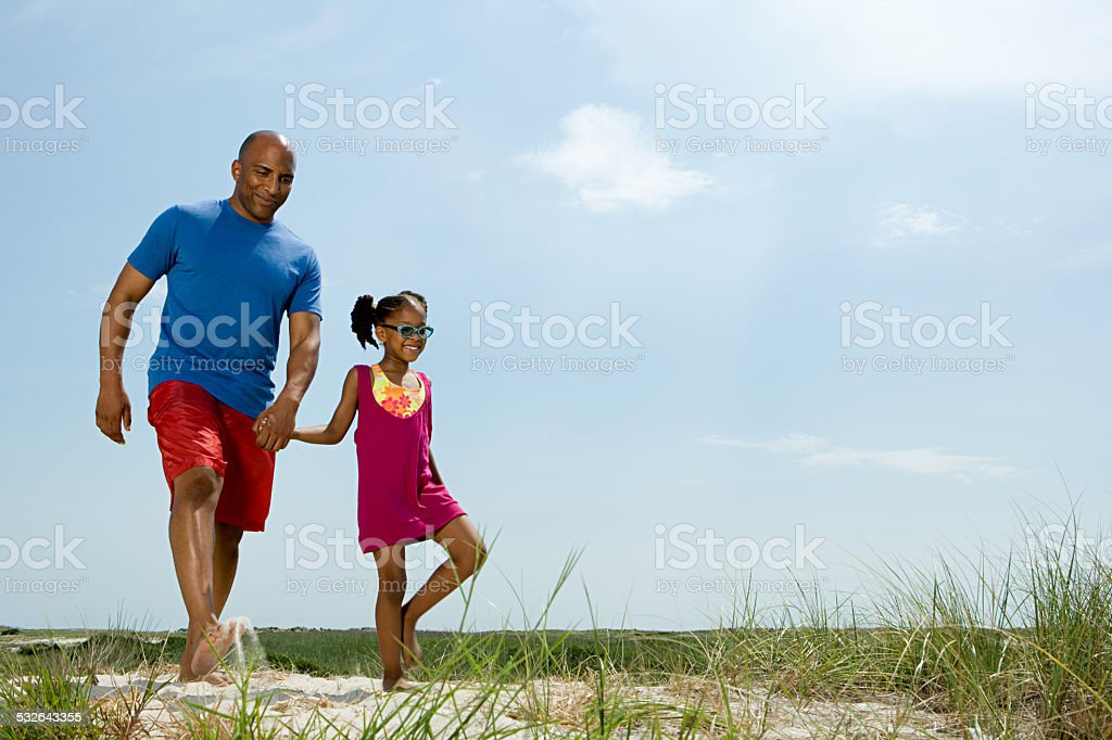 Father and daughter walking stock photo