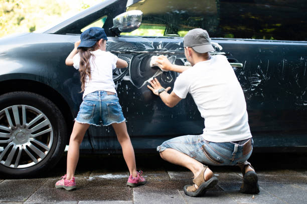 father and daughter wash the car - asian travel in car stock photos and pictures