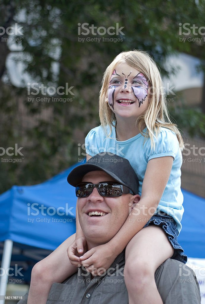 Father and Daughter Watching a Parade stock photo