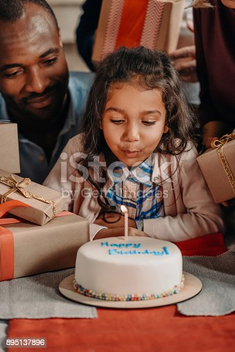 istock father and daughter with birthday cake 895137896