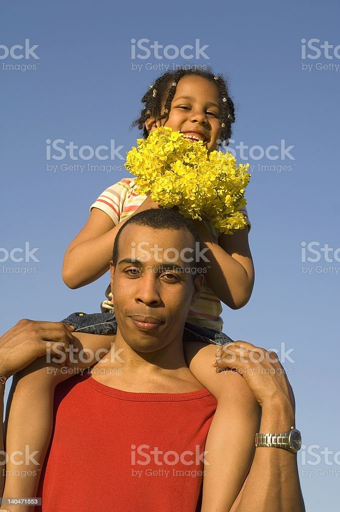 Father and daughter with blue sky royalty-free stock photo