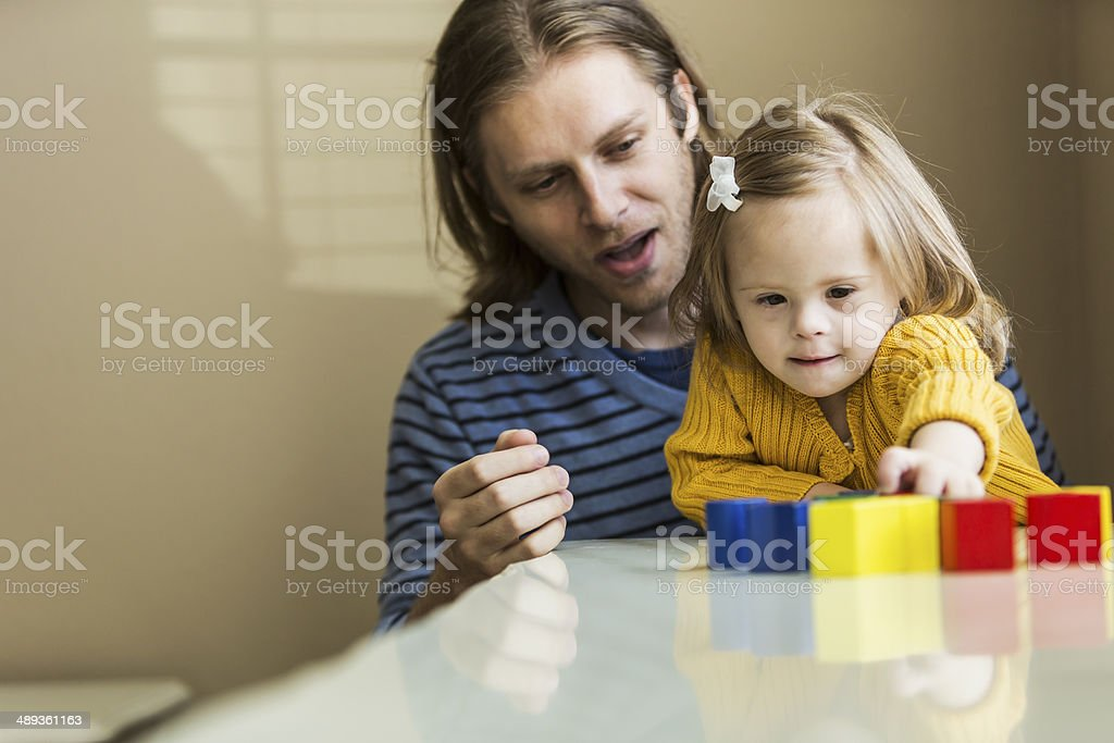 Father and daughter with down syndrome stock photo
