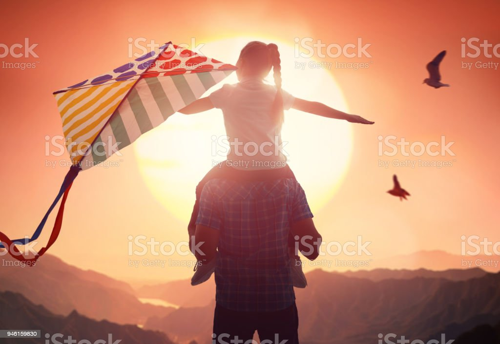 Father and daughter with kite stock photo