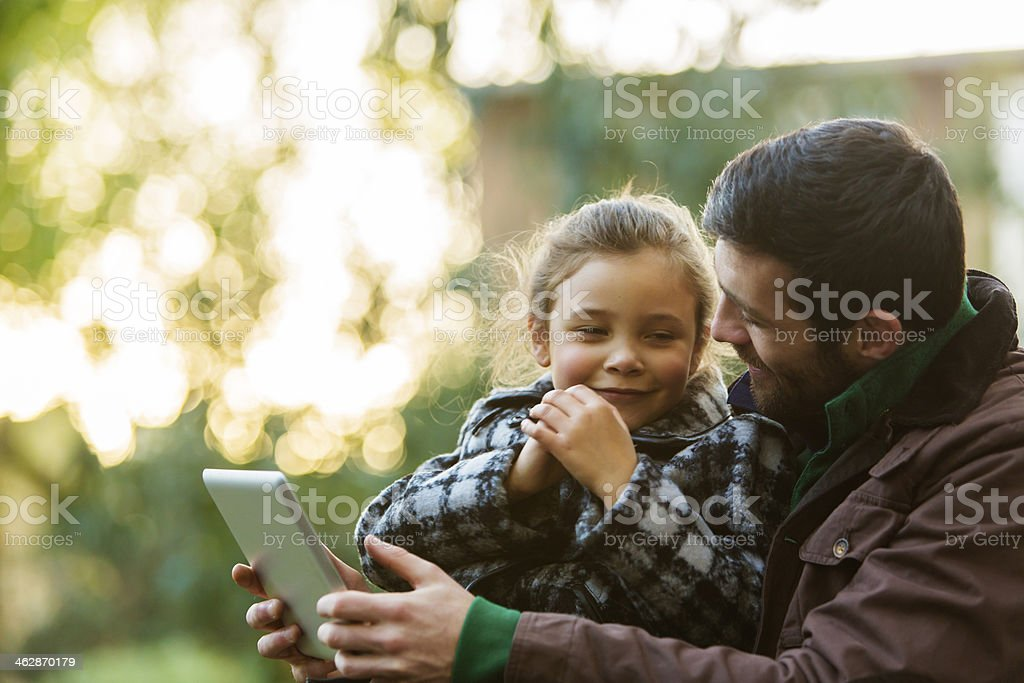 Father and Daughter With Tablet Computer stock photo