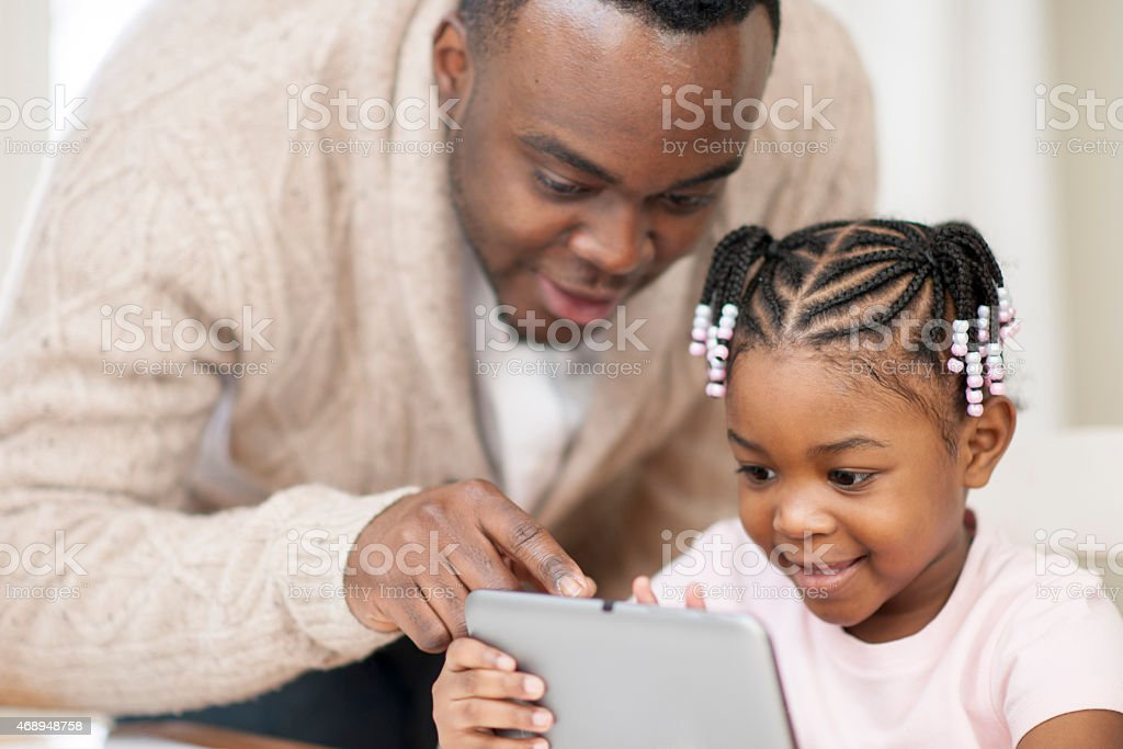 Father and Daughter with Tablet PC stock photo