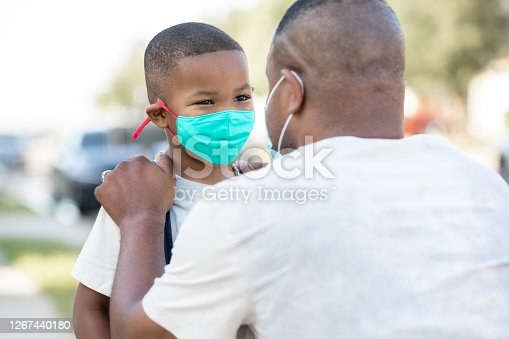 istock Father and elementary age son wear masks and say goodbye as father drops son off for first day back to school during time of coronavirus 1267440180