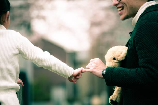 father and faughter make a promise - pinky promise stock photos and pictures
