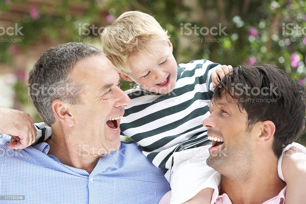 Father and grandfather laughing with grandchild royalty-free stock photo