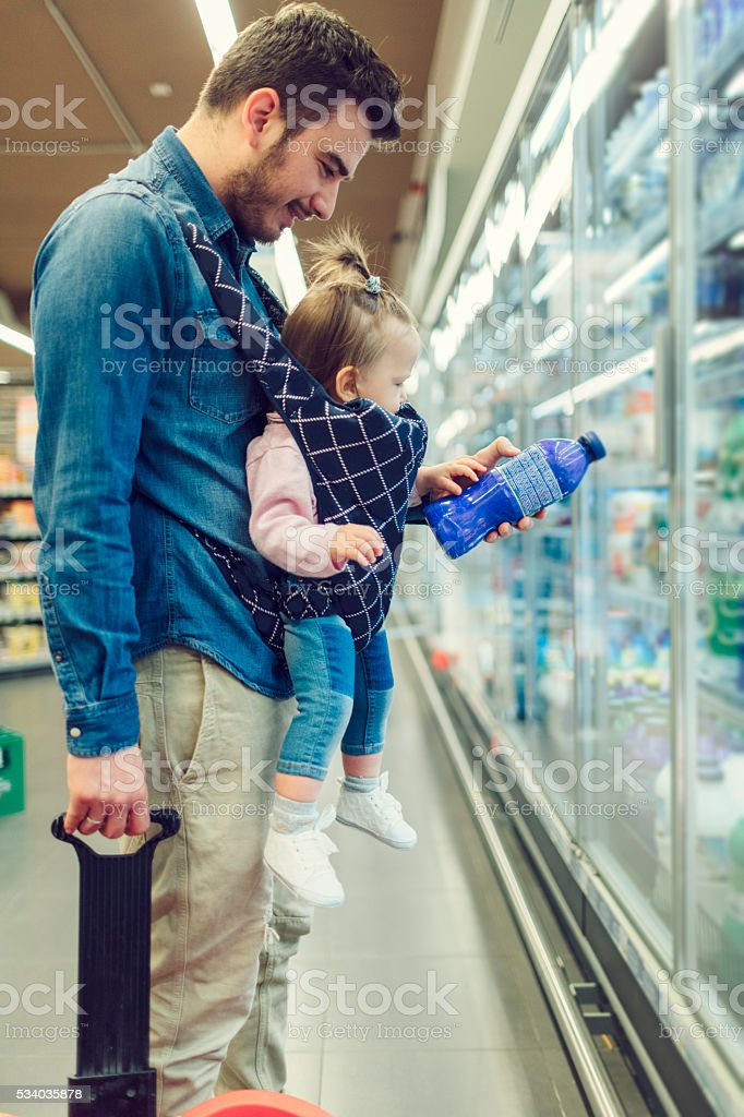 Father And His Baby Daughter Dairy Products Shopping. stock photo