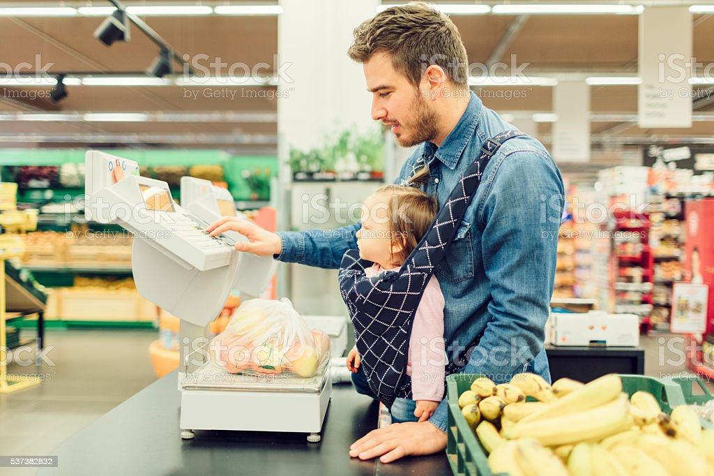 Father And His Baby Daughter Groceries Shopping stock photo