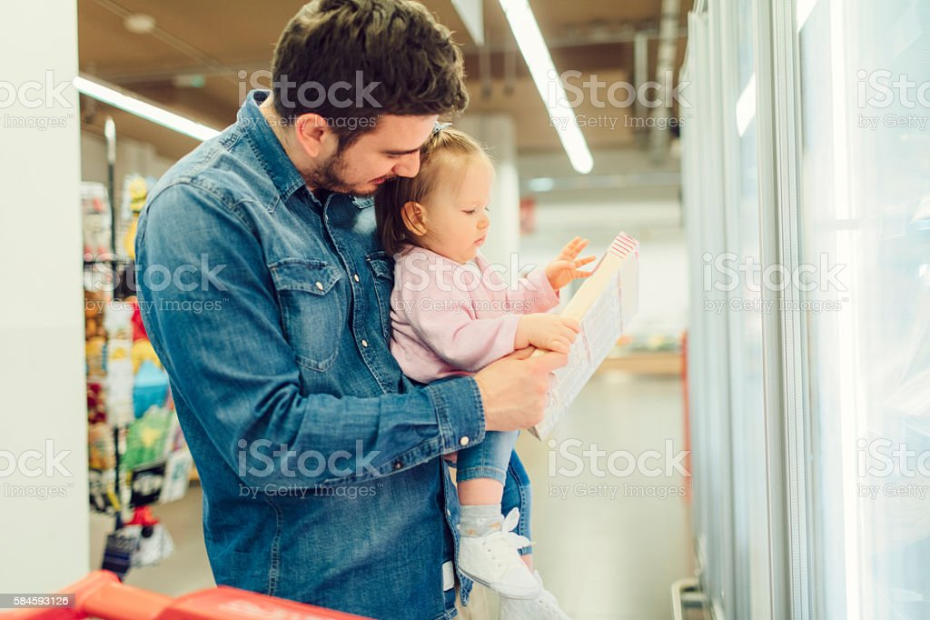 Father And His Baby Daughter Grocery Shopping stock photo