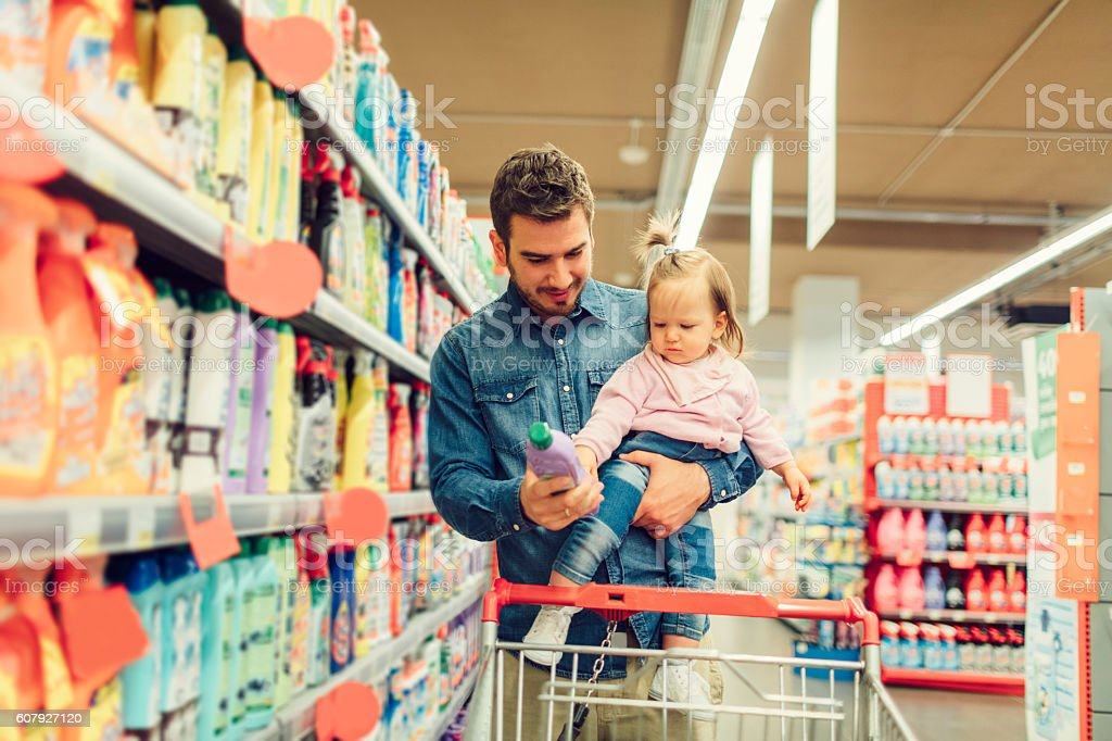 Father And His Baby Daughter In A Supermarket. stock photo