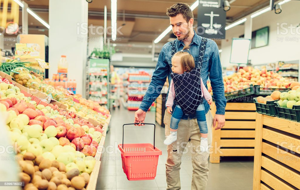 Father And His Baby Daughter In Groceries Shopping stock photo