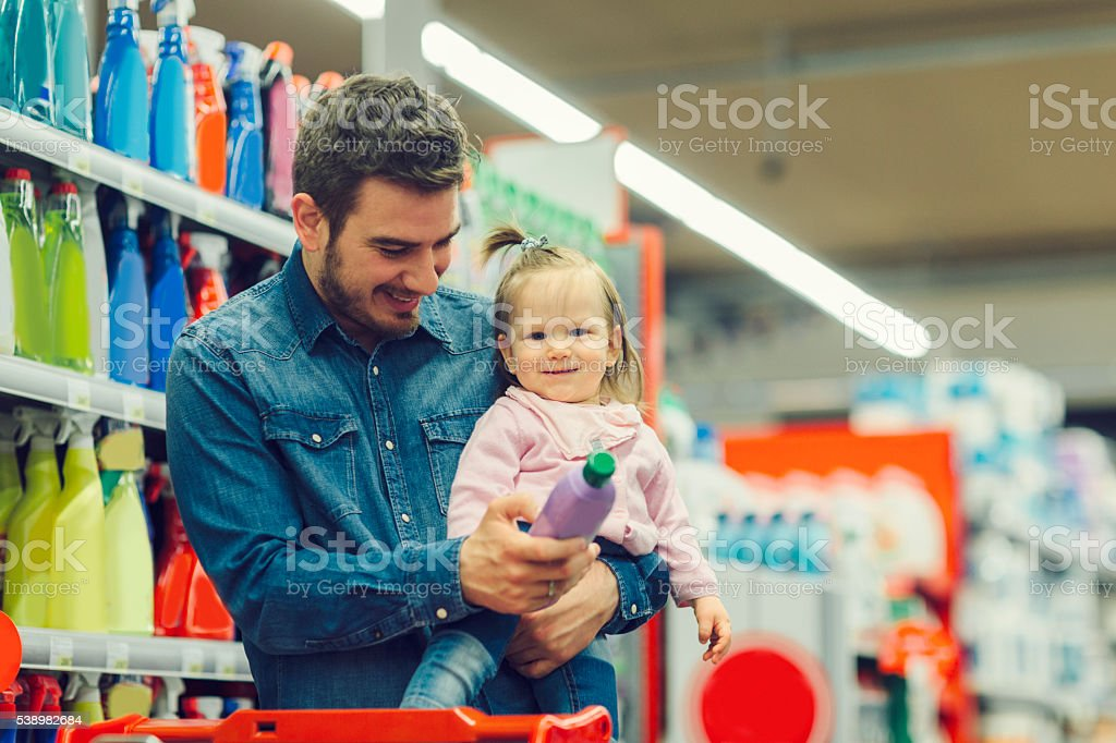 Father And His Baby Daughter In Local Supermarket. stock photo