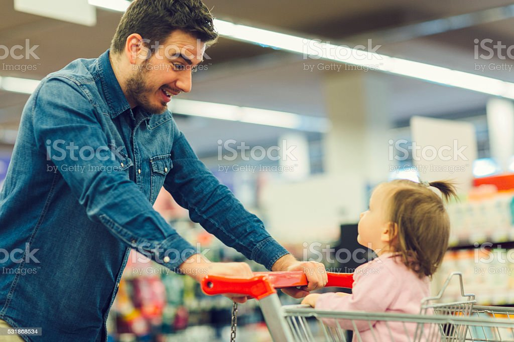 Father And His Baby Daughter In Shopping stock photo