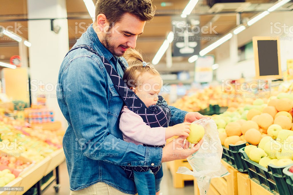 Father And His Baby Daughter Shopping Fruits. stock photo