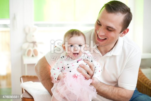 Father and his baby dauther in ballet dancer dress