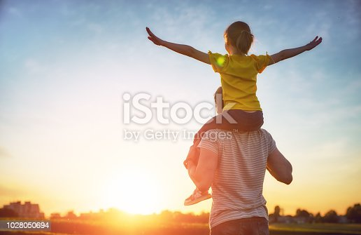 Happy loving family. Father and his daughter child playing and hugging outdoors. Cute little girl and daddy.