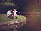 Father and his daughter bonding at the pond