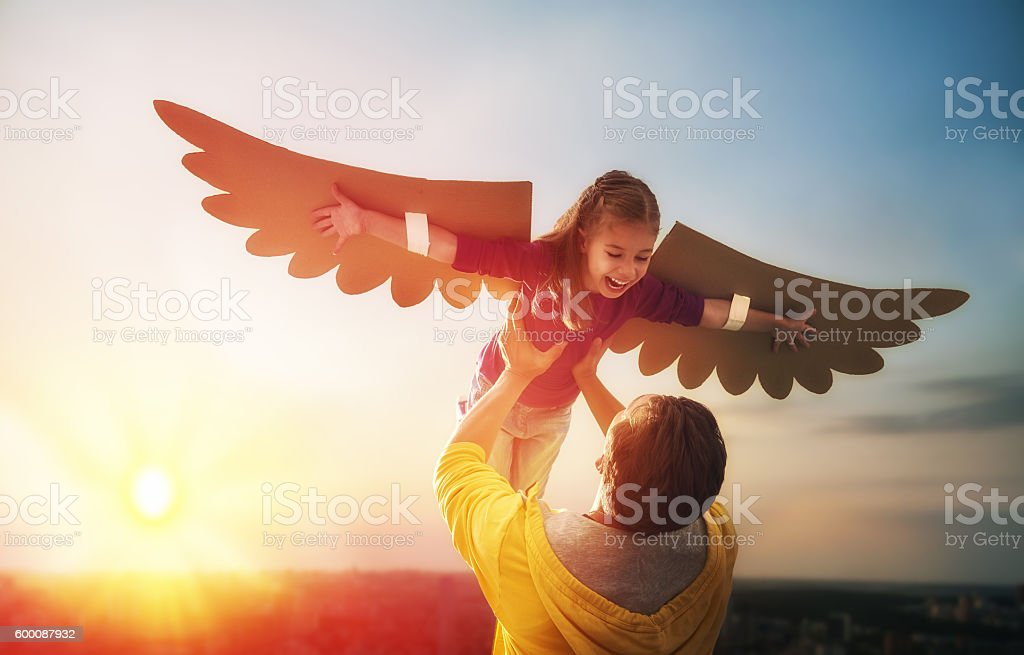 Father and his daughter playing stock photo
