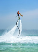 istock Father and his daughter posing at new flyboard at Caribbean tropical beach. Positive human emotions, feelings, joy. Funny cute child making vacations and enjoying summer. 960910122