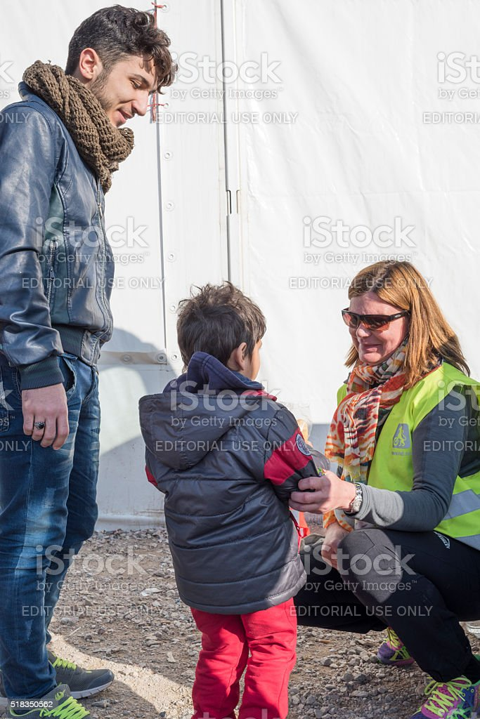 Father and his son standing in line to have breakfast stock photo