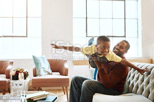 Shot of a family having fun indoors