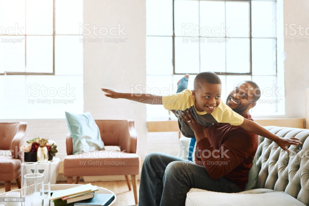 Father and I have the best fun indoors stock photo