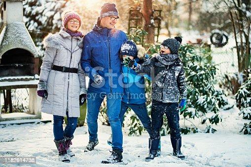 Father and kids having winter fun in back yard.  Nikon D850