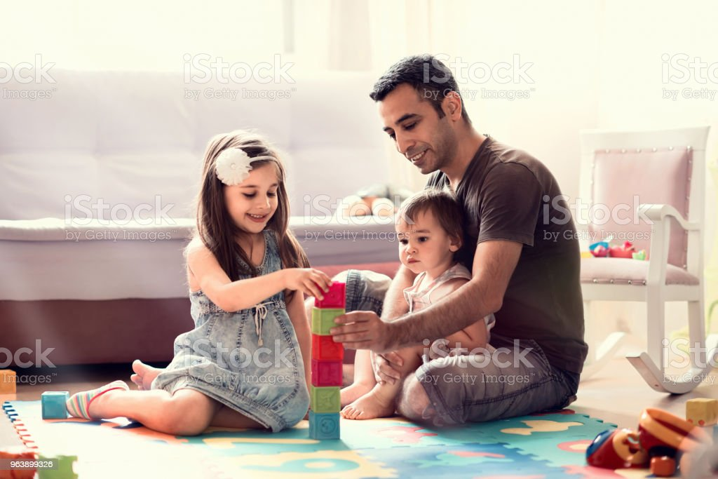 Father And Little Child Daughters Playing With Toys At Home - Royalty-free Adult Stock Photo