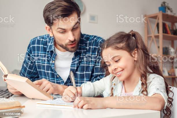 Father and little daughter at home sitting at table father helping picture id1163582498?b=1&k=6&m=1163582498&s=612x612&h=minorahzuwuce5td9ns1ur3x 1mnd7ii7ijvcryhfbe=