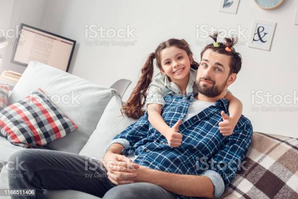 Father and little daughter at home sitting girl hugging father with picture id1166511406?b=1&k=6&m=1166511406&s=612x612&h=v2uvclw0fqov87grxdcgzskseo4rluaso2l1 cjqifg=