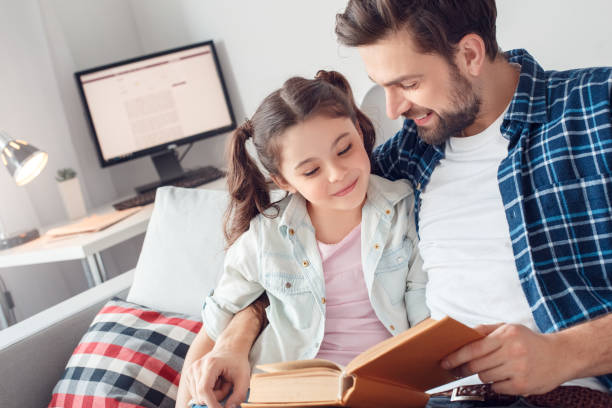 Father and little daughter at home sitting hugging man reading to picture id1166112211?b=1&k=6&m=1166112211&s=612x612&w=0&h=l7wjyqhjpkesgirt06iql86hd3uokdpjfron obzgk8=