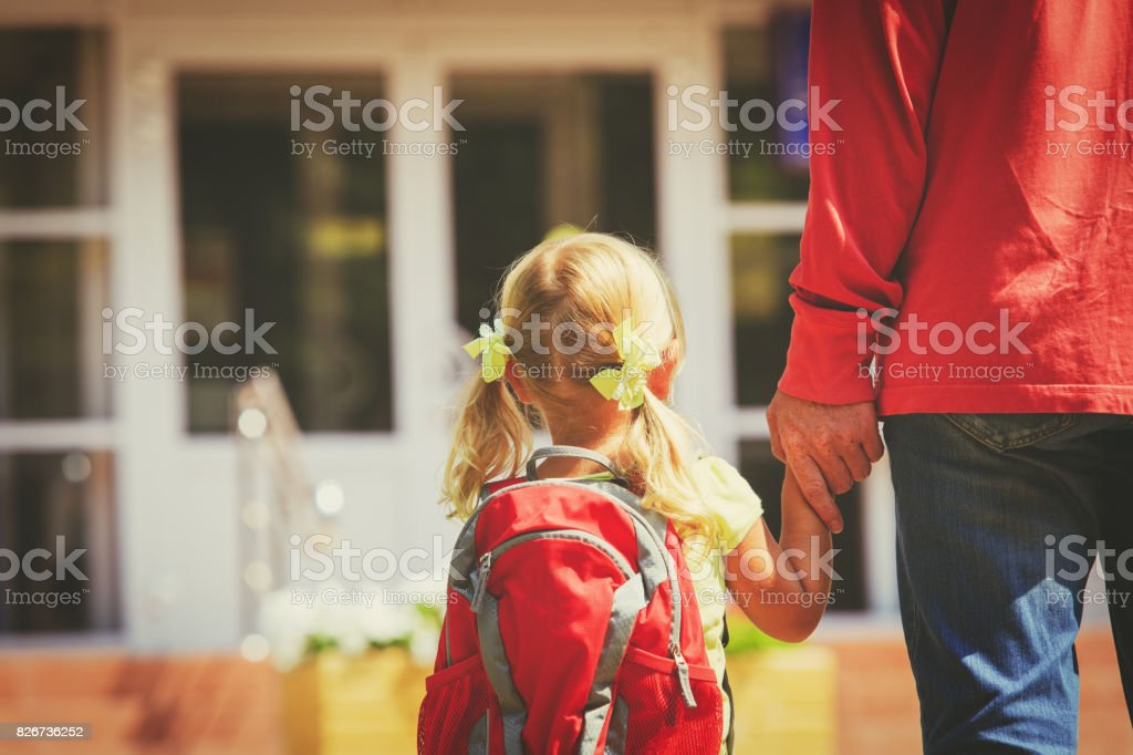 father and little daughter go to school or daycare - foto stock