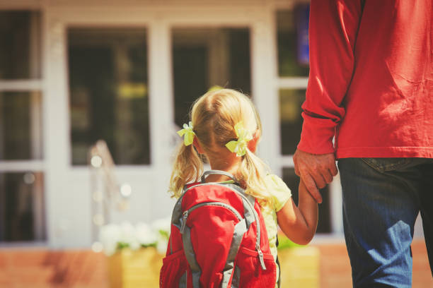 father and little daughter go to school or daycare - preschool stock photos and pictures