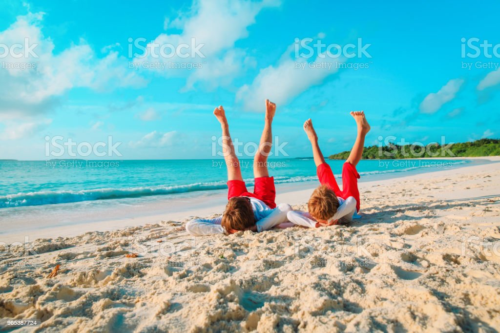 father and little son play on beach royalty-free stock photo