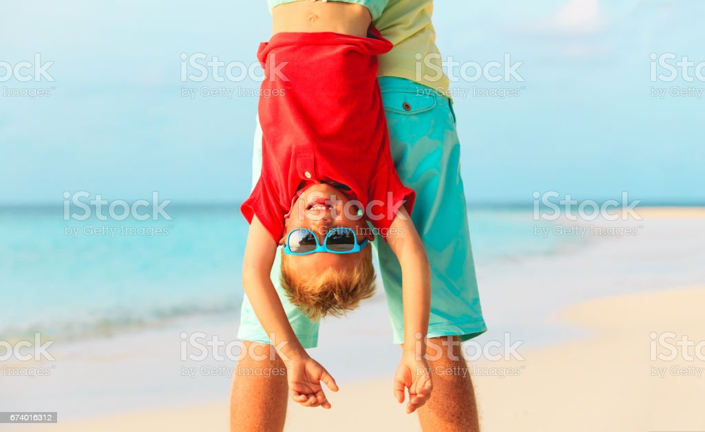 father and little son playing on beach royalty-free stock photo