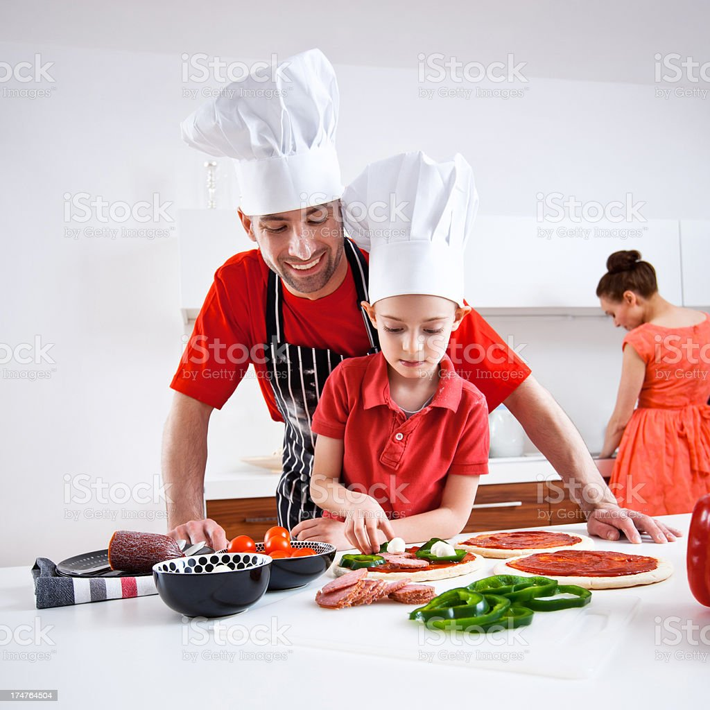 Father and little son preparing pizza royalty-free stock photo