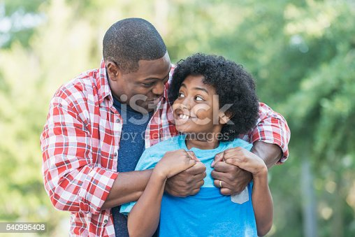 1091098220istockphoto Father and mixed race preteen son 540995408