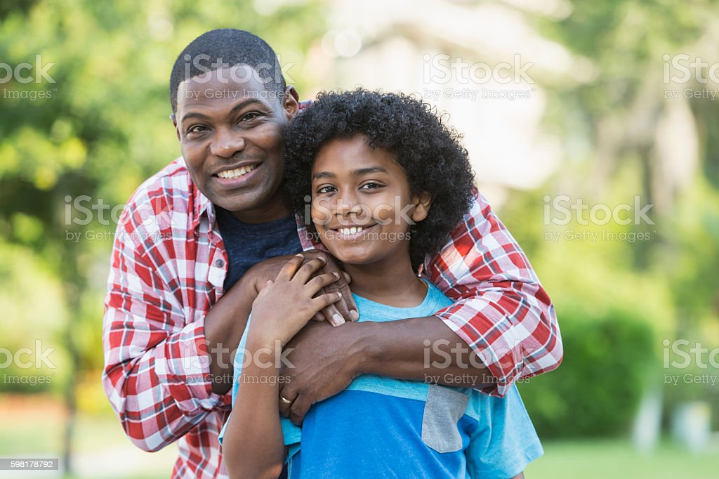 Father and mixed race preteen son stock photo