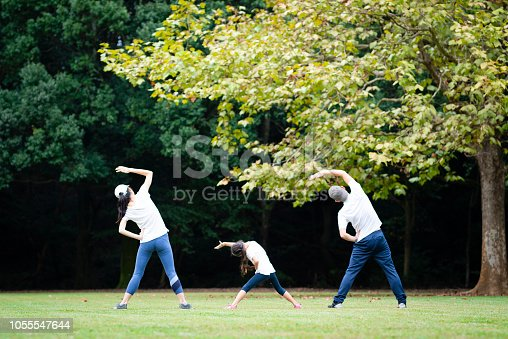 istock Father and mother and daughter to the stretch 1055547644