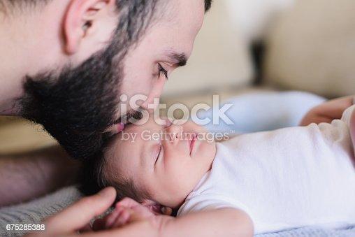 istock Father and newborn baby closeup 675285388