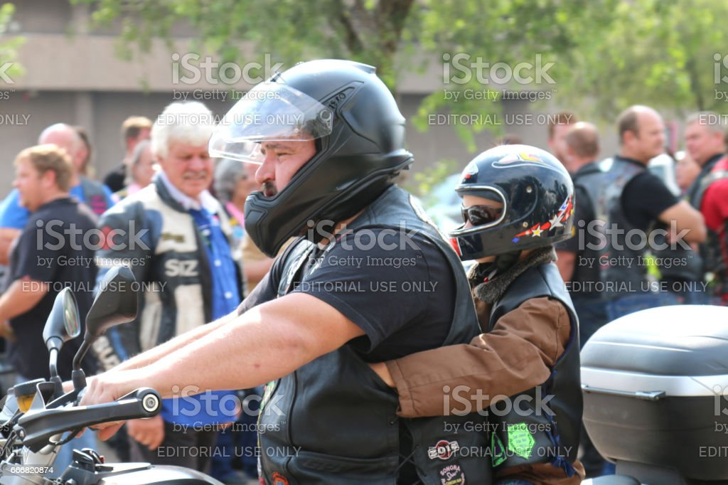 Father and small boy on motorbike at Yearly Mass Ride stock photo