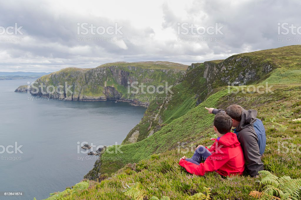 Father and son admires beauty landscape. stock photo