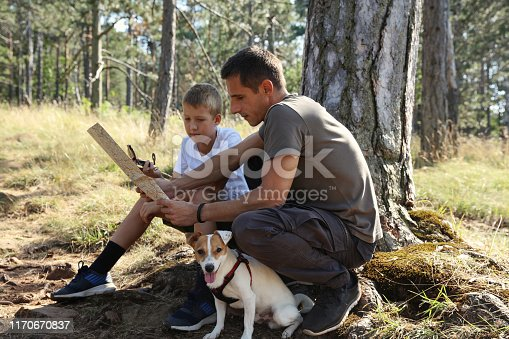 istock Father and son adventure time. Family travel in nature,hiking in mountains 1170670837