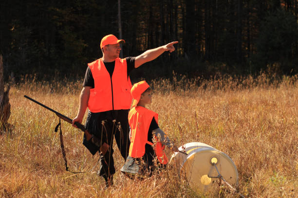 Father and son are hunting stock photo
